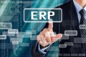 43367192 - businessman hand touching erp (or enterprise resource planning) sign on virtual screen